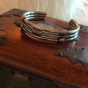 Silver tone bracelet with brass accents